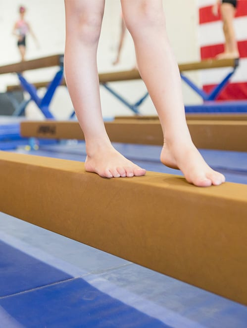 3x4-image_510pxfeet-on-balance-beam